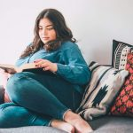 plus size woman reading a book