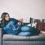 Plus size woman lounging on couch