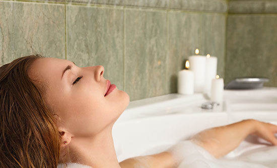 Woman in tub relaxing with Dr Teals