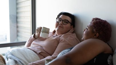 Plus size couple laying in bed